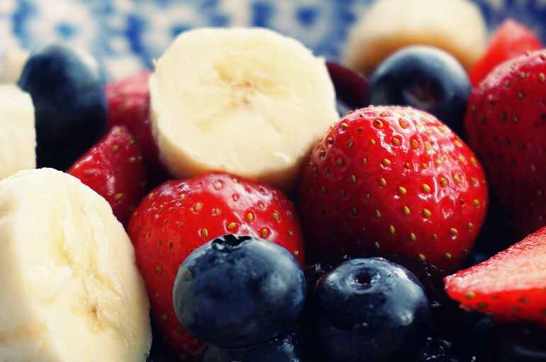 sliced strawberries banana and blackberries